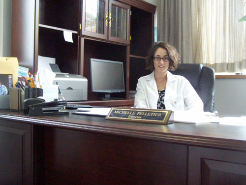 COURTESY PHOTO | Michelle Pelletier at her desk in downtown Riverhead's Long Island Science Center.