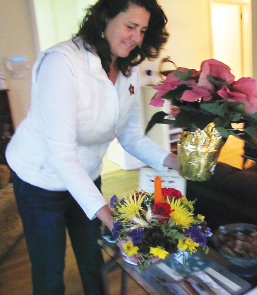 Ms. Pike rearranges flowers for Saturday's open house. (Credit: Paul Squire)