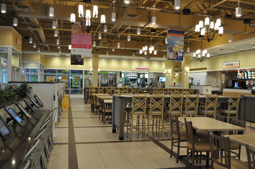 "Tanger 2's food court was recently renovated and features raised seating and, at left, an ""iPad bar"" with 20 iPads for customer use."