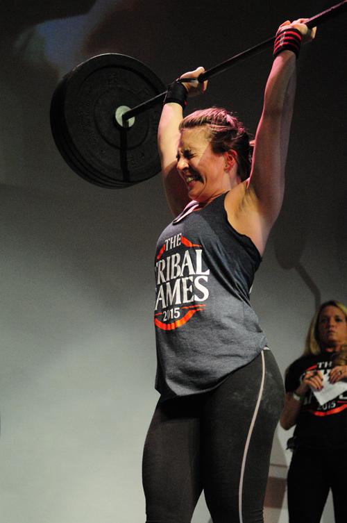Brooke Weaver of East Marion gets the bar above her head. (Credit: Bill Landon)