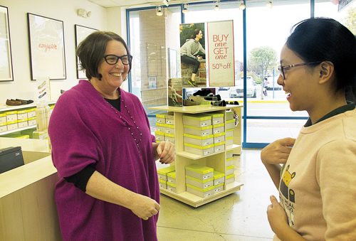Yating Liu (right) meets with Annie Wieland, the store manager who discovered her purse at Tanger Outlets earlier this month. Ms. Wieland had the purse sent halfway around the world to China, hoping to return it to its owner. (Credit: Paul Squire)