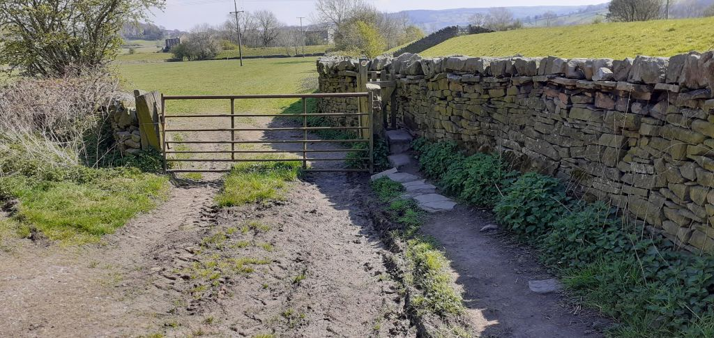 Stile into field from farm track
