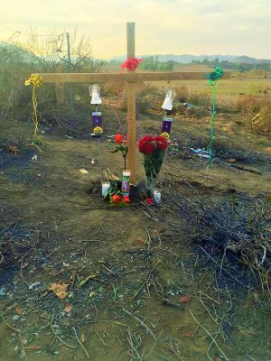 A makeshift cross now sits near the scene of yesterday's fatal triple car accident.