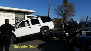 Hemet PD officers taking the victim's SUV to process the vehicle for potential evidence. J.P. Kemp photo