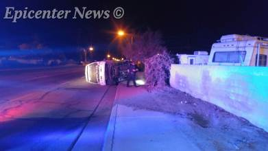 The truck was left on its side after the driver fled from it. Miguel Shannon / Epicenter News phot