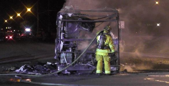A firefighter finishes fighting the blaze that completely destroyed the RV. Hemet News photo