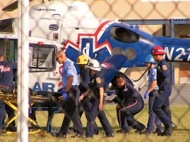 The severely scalded child was transported to the elementary school before being flown to an area trauma center. Ricardo Ruelas photo