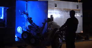 A law enforcement robot is brought out of it's trailer to assist in the standoff. Image courtesy of Loudlabs News
