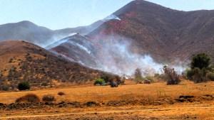 Fire moves across a hillside along Lakeland Village. Miguel Shannon photo