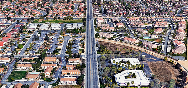 Northbound aerial view of Heacock St. in Moreno Valley. The accident occurred just past the Riverside Superior Courthouse, which can be seen in the lower right corner of the image.