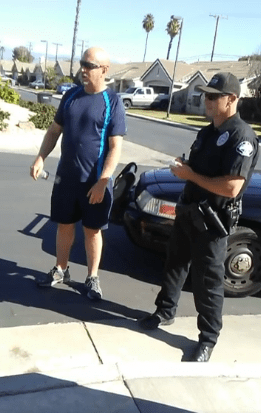 Officer Shawn speaks with Brian, learning how Elizabeth came to be found wandering in his gated community. Martin Martinez screenshot
