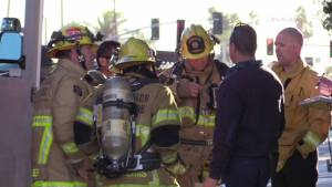 Firefighters put on their equipment while preparing to enter the hospital's Emergency Room. William Hayes photo