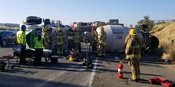 Driver injured after cement mixer overturns on I-215