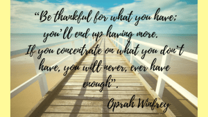 A quote of being thankful on a sunny pier
