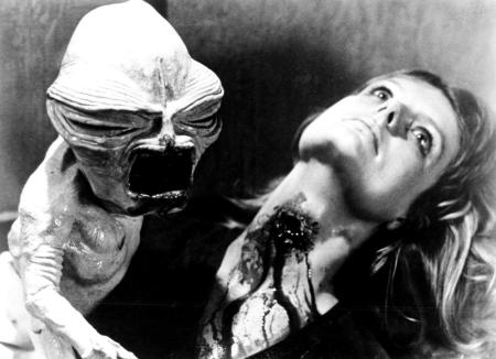 INSEMINOID, (aka: Horror Planet), alien vampire baby creature attacking, Heather Wright, 1981. (c)RKO