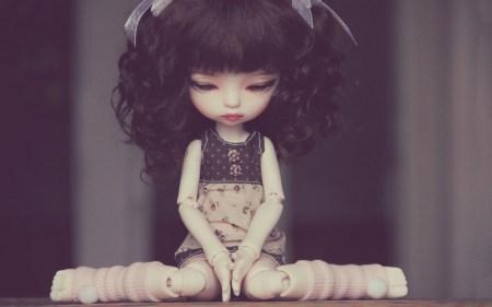 sad-doll-sitting-wallpaper