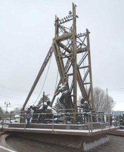 Carol walks on a monument to oil well riggers