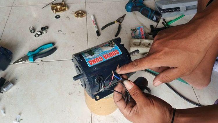 Gambar cara mengganti kapasitor pada pompa air