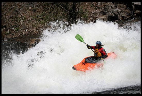 kayaker in whitewater rapids