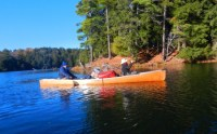 Canoeing Upper Peninsula Michigan: man and woman paddling on lake