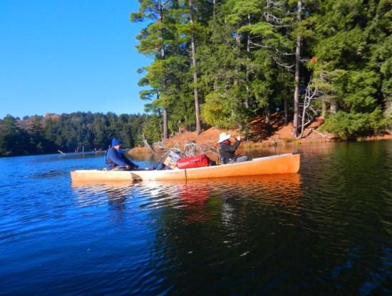 Canoeing Upper Peninsula Michigan: man and woman paddling on lake