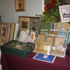 display of original Dreer's catalogs and postcards, reproductions in frame and at far left