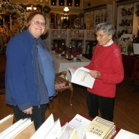 Pat Lynch and Nancy Hall peruse the gifts available for the history enthusiast - Ruff Copy, Historic Riverton, History of Riverton Fire Co., Romance of Riverton, back issues of Gaslight News, History of Palmyra, repro maps and photos.