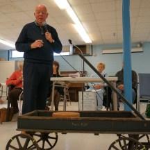This circa 1900 wagon has iron wheels.