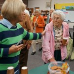 Mrs. Elsie Waters on right; Mrs. Susan Dechnik on left; fast disappearing cookies on table