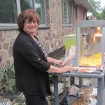 Donna Maratea, Director of Activities and part-time popcorn vendor