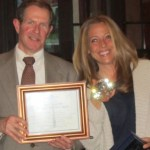 """Dan Campbell, left, Adrienne Rogers, right, with the Society's """"Diamond in the Rough"""""""