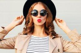 Fashion portrait pretty sweet woman blowing red lips, black hat