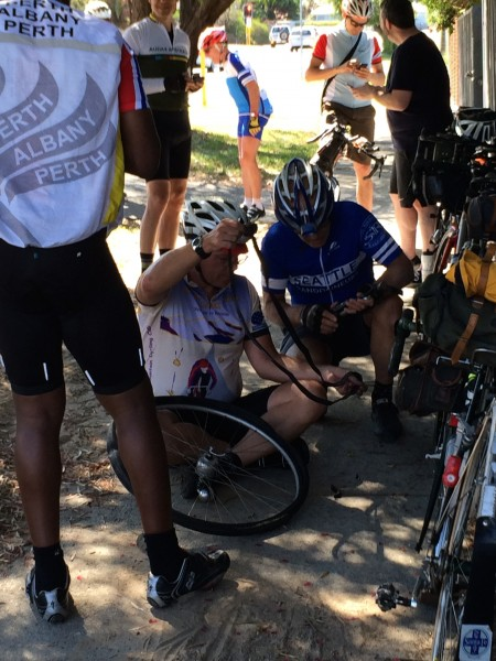 How many randos does it take to fix a flat? Flat # 3. Pre-ride to Freo. photo: Banks