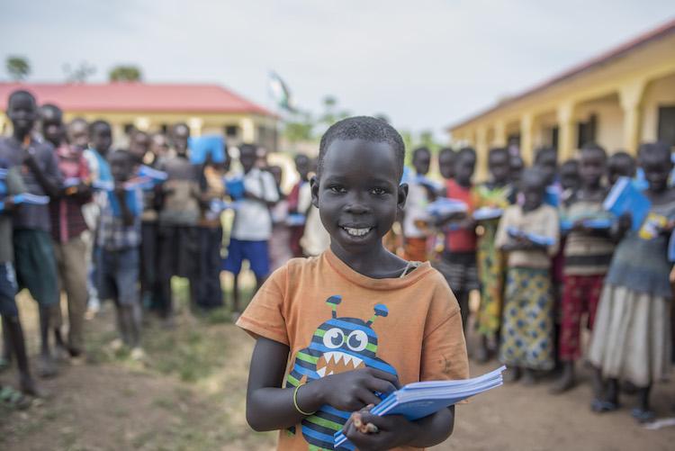 Ajiba gets new school supplies Plan International