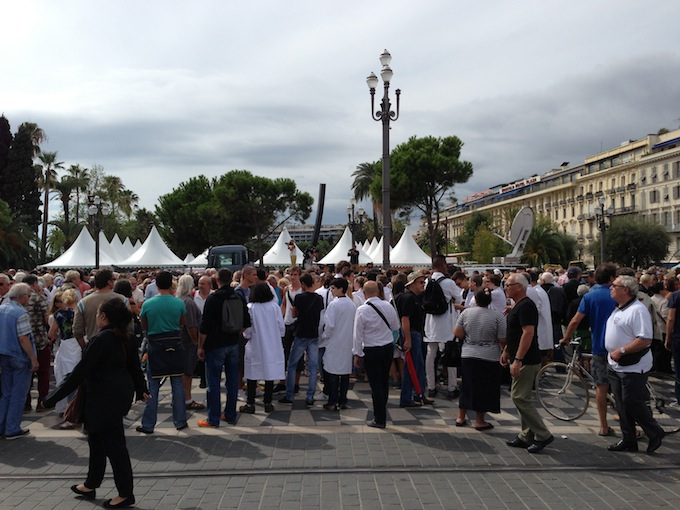 People at demonstration in Place Masséna in Nice in support of the jeweller who shot a man