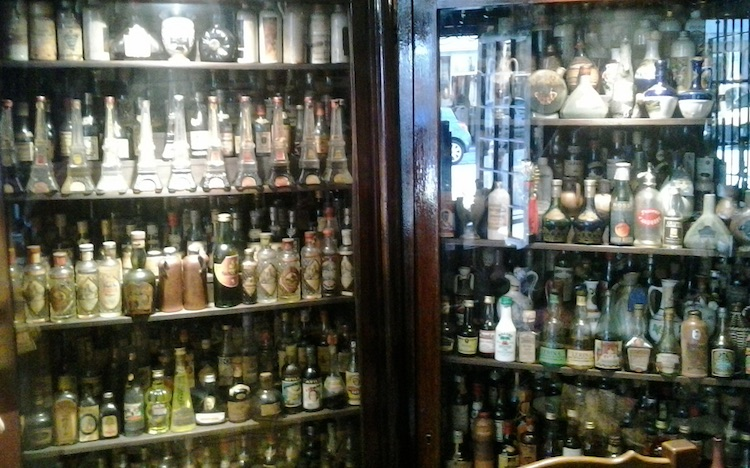 Schnapps bottle collection at La Gargamelle in Nice