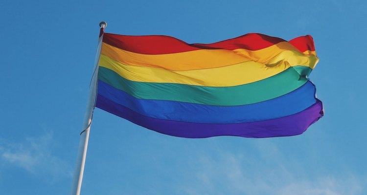 Pride flag by Kirsty Lee on Unsplash