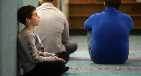 A Muslim child fell in sleep at the mosque