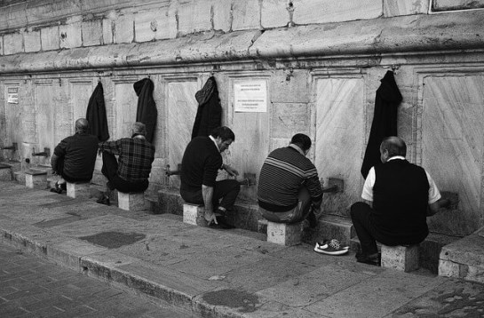 Some Muslims performing wudu (ablution)