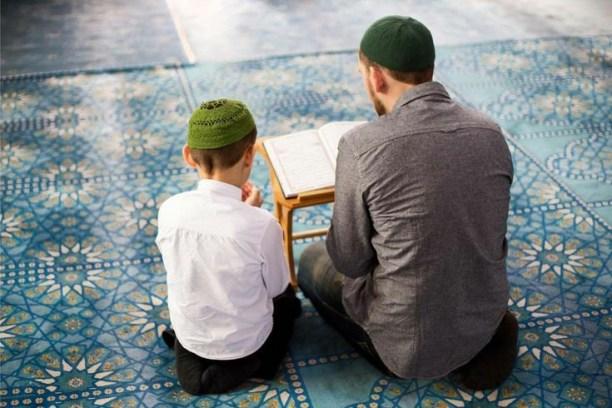 An adult teaching a child Arabic