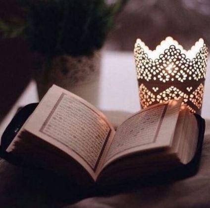 Ramadan lantern beside a Mushaf