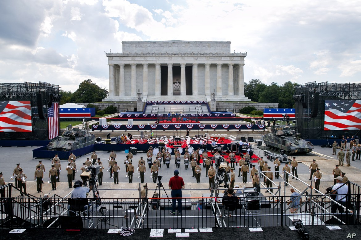 Two Bradley Fighting Vehicles flank the stage being prepared in front of the Lincoln Memorial, Wednesday, July 3, 2019, in Washington, ahead of planned Fourth of July festivities with President Donald Trump.