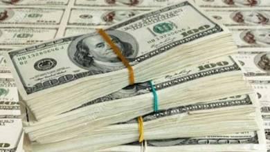 Photo of رزم دولارات أمريكية كثيرة