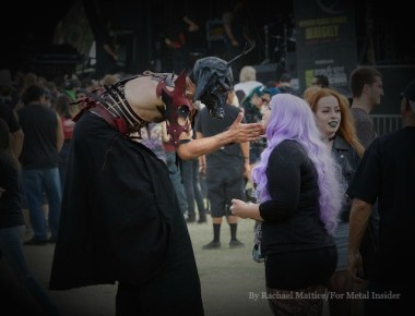 A carnival stilt walker meets a metal fan at Knotfest at San Manuel Amphitheater in San Bernardino, Calif. on Sunday, October 25, 2015. (Photo by Rachael Mattice/For Metal Insider)