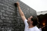 """""""Concert goers sign a brick wall outside the Chicago Open Air music festival VIP area on Friday, July 14, 2016 at Toyota Park in Bridgeview, Ill. Photo by Rachael Mattice/For Metal Insider."""""""