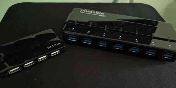 Old Belkin USB 2.0 7-port USB hub (left) versus new Plugable 7-port powered USB 3 hub (right)