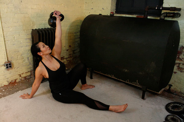 Proper shoulder position—Shoulder is rounded back and in line with the hand.