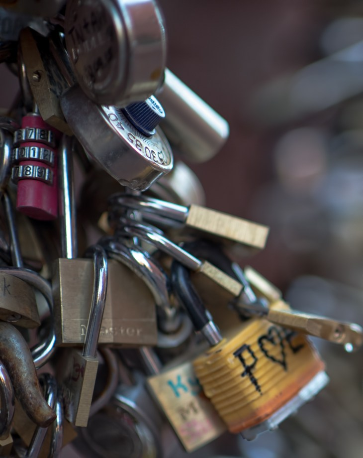 Close up on a wall of locks one the business district in Toronto, Ontario, Canada