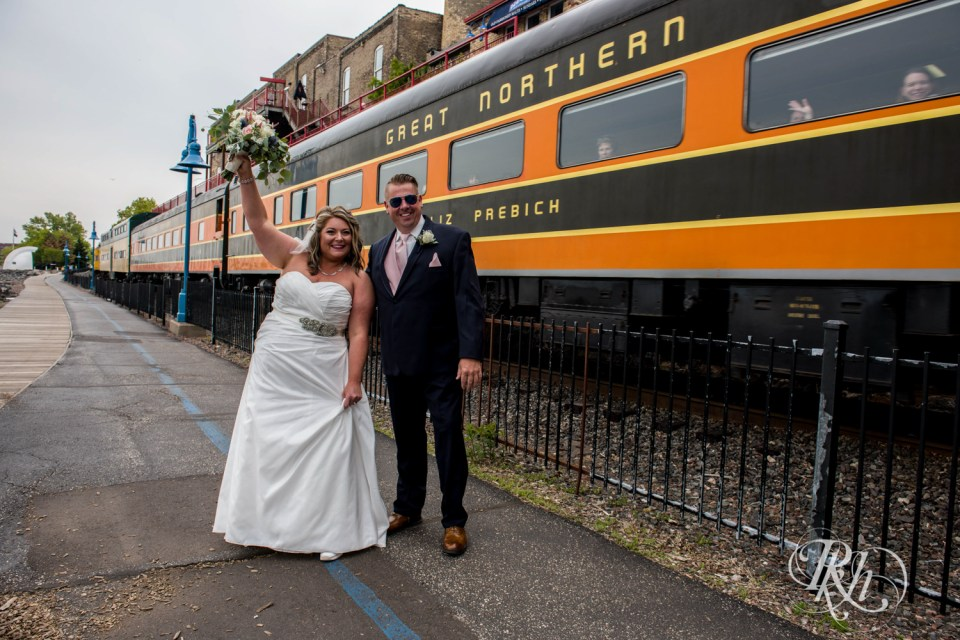 Train behind bride and groom