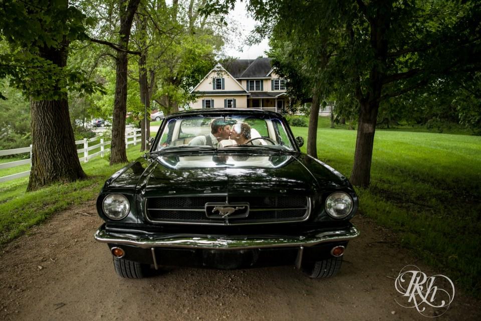 Bride and groom in Mustang convertible